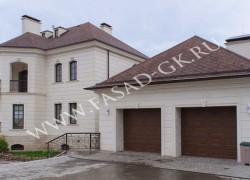 Облицовка фасада дагестанским известняком. Отделка цоколя дома мраморизованным известняком